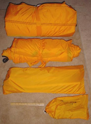This is (Top to bottom) the inner tent outer tent poles then stakes with a 12  ruler in for scale. & ArcticOven