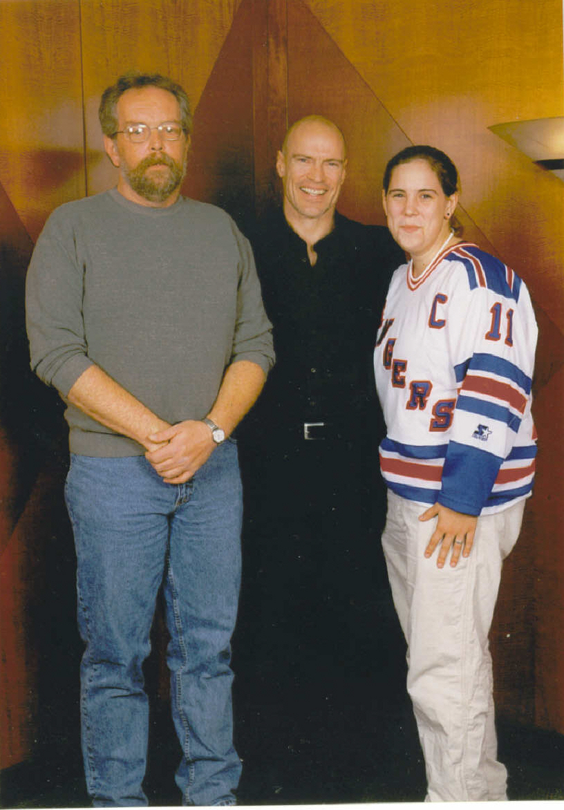 My father and I standing with the captain of the New York Rangers, Mark Messier