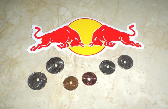 Red Bull sticker and six 'holy' coins
