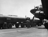Refueling truck infront of a C-47