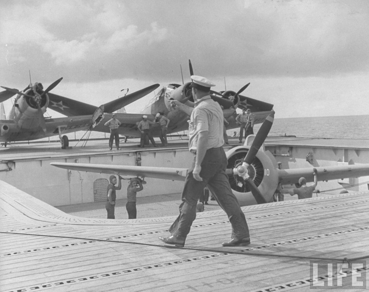 F4F-3 Wildcat of VF-6 being struck up from below