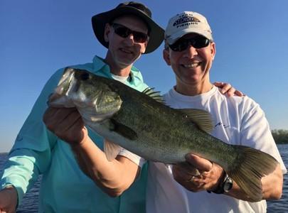 NFL veteran Weegie Thompson fishing with his friend Mike.