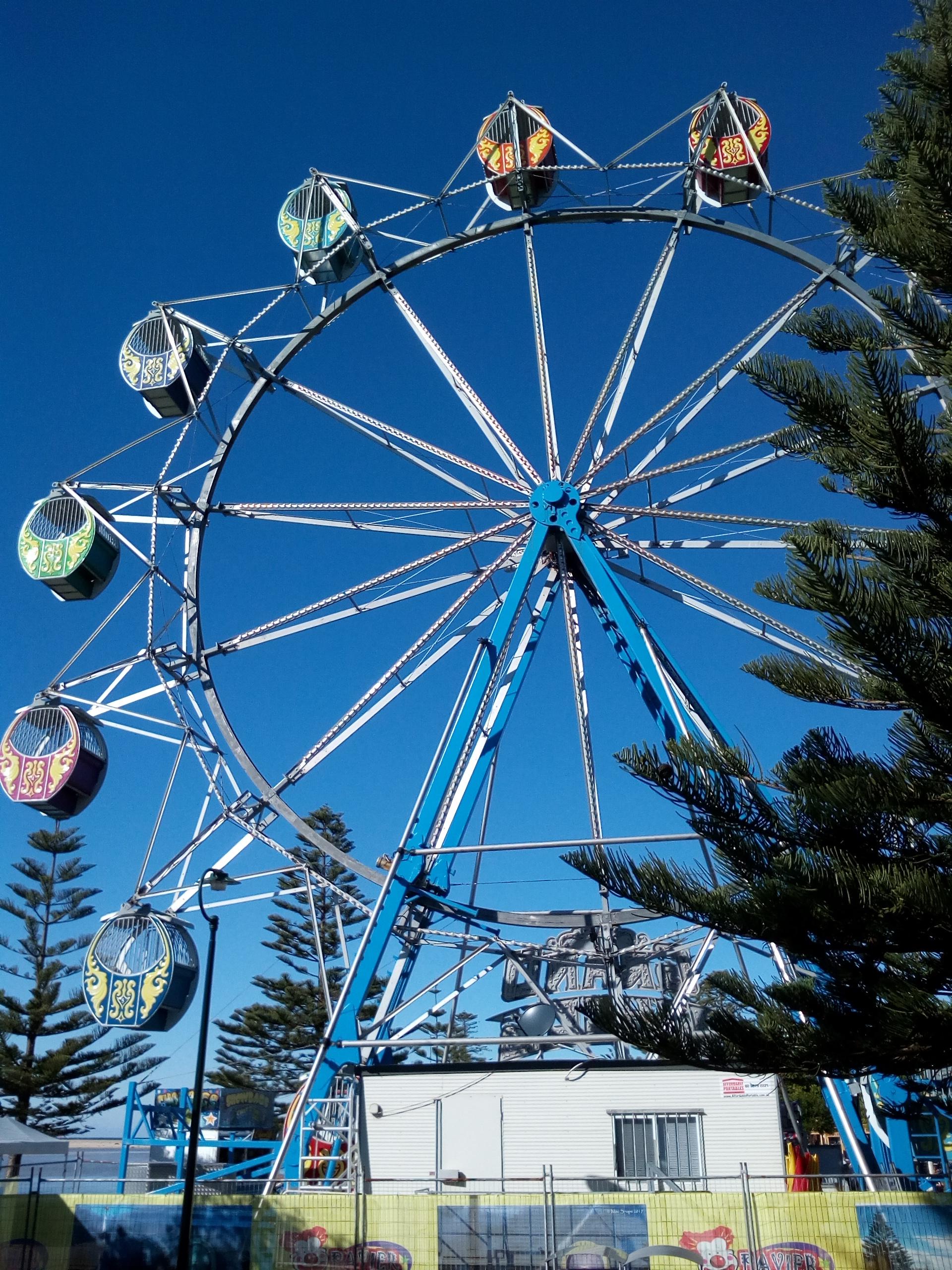 A ferris wheel, a vertical carousel, at The Entrance