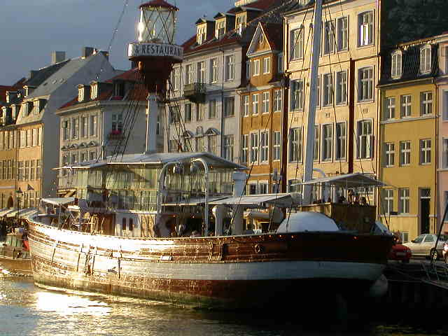 The beautiful golden summer afternooned canals of Nyhavn, Copenhagen, Denmark