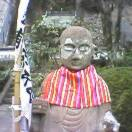 Ojizo in his distinctive bib at Yakuoji Temple in Shikoku