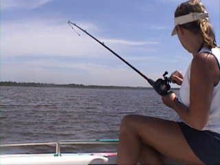 Amanda reeling in a catfish.