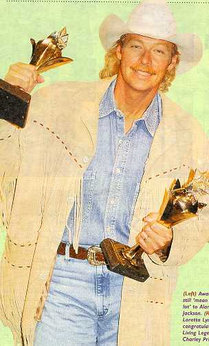 Alan Jackson receiving another award