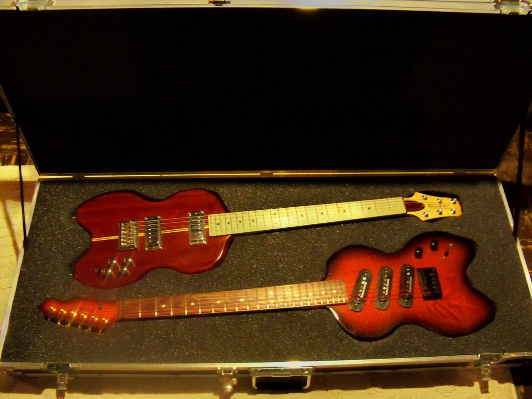 4e60f1c6228 Two guitars, one ATA case... The two guitars combined way only 2/3 what the  case empty weighs. One is for LP/335ish tones and the other is for  Strat/tele ...