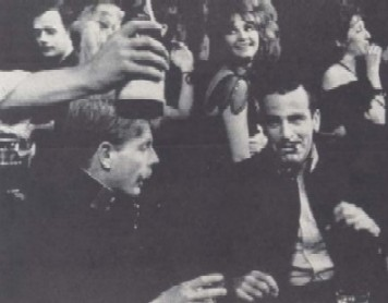 Edward Fox and Maximilian Schell celebrate in Anna's Cafe