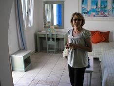 Sharon, the owner of Villa Konstantin in Mykonos town showing me one of the apartments