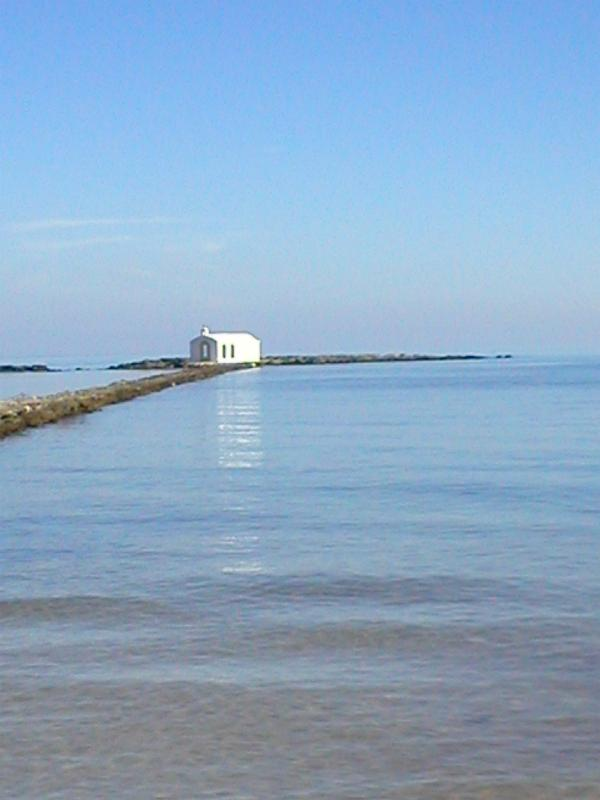 The small church on the pier in the sea at Georgioupoli.