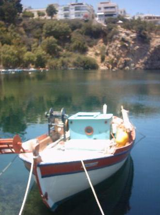 Boat in the harbour of Agios Nikolaos