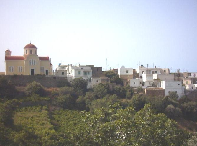 The yellow church on top of the hill at Exo Mouliana
