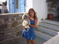 Anna and her dog Tina at the entrance of Ikia in Paros