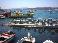 Boats in Aliki harbour. You can have dinner in the sea!