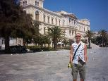 My friend Maxim admiring the town hall on Miaouli Square.