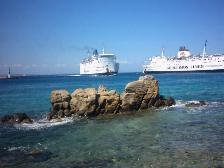 Ferries sailing into Mykonos harbour