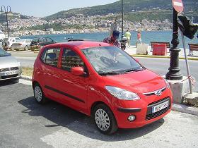 Onze mooie nieuwe rode auto