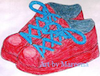 A child's red shoes with laces