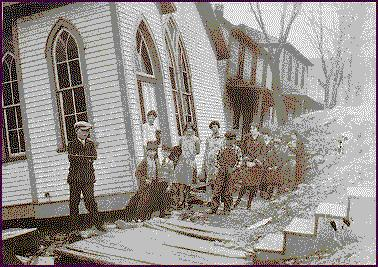 kids in front of damaged church