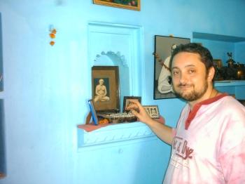I am touching Lahiri Mahasaya's shoes whilst visiting the house of Shibendu lahiri - Grandson of the great Master - in Varanasi - India / March 2004